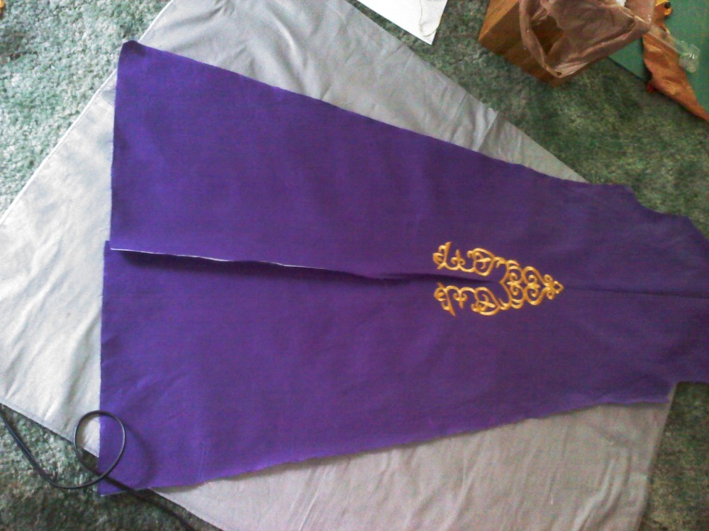 Putting the appliques on the back of the purple coat.