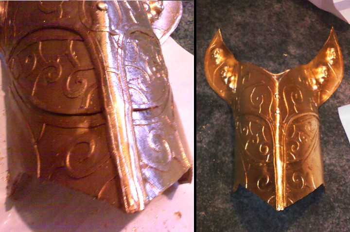 Genie being covered with gold leafing.