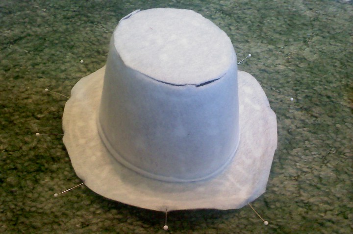 Covering the hat in white felt.