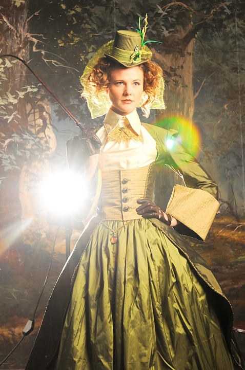 Outtake of Brin as Philomena in the Green Riding Dress in front of Edgar S. Paxon's original backdrop.