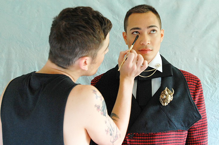 Sam works on Devon's make-up.