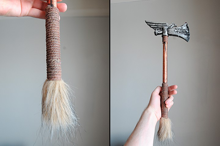 The hatchet has a faux fur bottom and is wrapped with natural fiber rope.